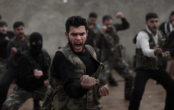 Syrian rebels attend a training session in Maaret Ikhwan, near Idlib, Syria.