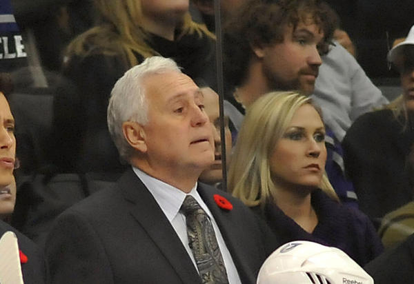 Tampa Bay Lightning head coach Guy Boucher, top left, and assistant coach Wayne Fleming, top right, watch during a game against the Los Angeles Kings at Staples Center.