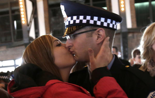 Danielle Williams kisses her boyfriend, new Chicago Police Officer Thomas Alagno, after he received his certificate at today's Chicago Police Department graduation ceremony at Navy Pier.