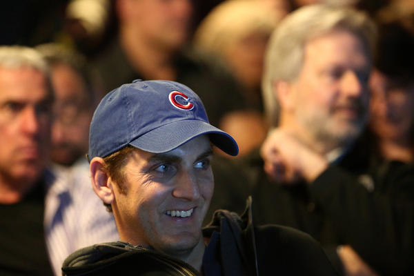Lakeview resident Brian Gustavson laughs during an annual meeting for Cubs and city officials to report to the public about what's going on with Wrigley Field and the surrounding neighborhood at the 19th District Police Station in Chicago.