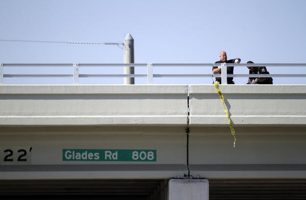Boca Raton Police investigate after a man jumped off a bridge at Glades Road at Military Trail around 4 p.m. on Tuesday. The unidentified man was pronounced dead with no foul play suspected.