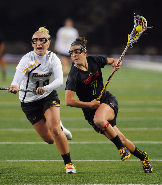 Maryland's Katie Schwarzmann, right, runs pass Towson's Breanna Hamm to shoot in the first half. Schwarzmann had five goals and 2 assists in the game.