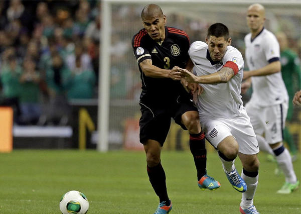 Mexico's Carlos Salcido, left, and United States captain Clint Dempsey vie for the ball during a 2014 World Cup qualifying match at the Aztec stadium in Mexico City.