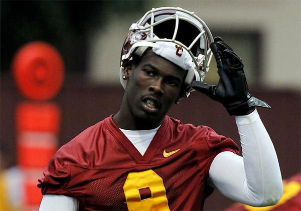 Wide receiver Marqise Lee takes his helmet off on the first day of spring practice at USC.