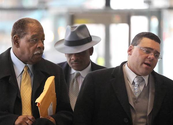William Beavers, second from left, leaves the Dirksen U.S. Courthouse with his defense team earlier this month. The team was stunned that among 50 prospective jurors for Beavers' federal tax evasion trial, not one was an African-American man.