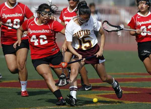 Glendale's Odalis Luna, left, and La Cañada's Christine Noh fight for the ball during a game Tuesday.