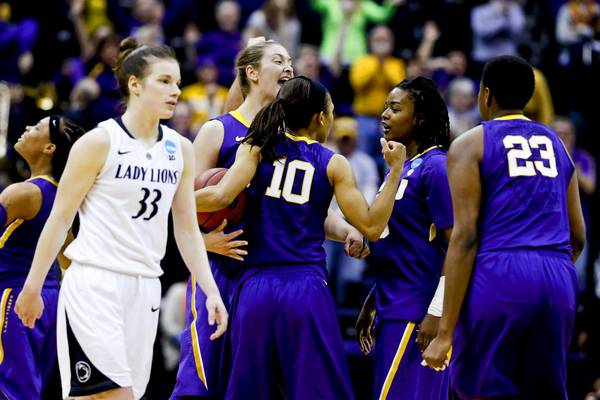 Penn State Lady Lions guard Maggie Lucas (33) walks off the court as LSU Tigers players celebrate a win during the second round of the 2013 NCAA women's basketball tournament at Pete Maravich Assembly Center. LSU defeated Penn State 71-66.