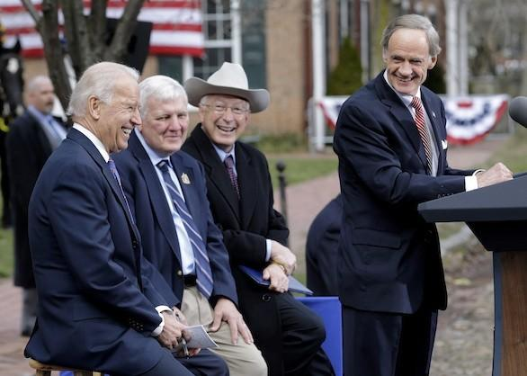 Sen. Tom Carper (D-Del.) right, speaks during a ceremony in New Castle, Del., on Tuesday at First State National Monument. Seated behind Carper, from left, are Vice President Joe Biden, New Castle Mayor Donald Reese and Interior Secretary Ken Salazar.