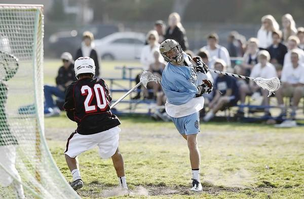 Corona del Mar High's Jack Ortlieb shoots and scores over Monte Vista's Nicholas Stailey.