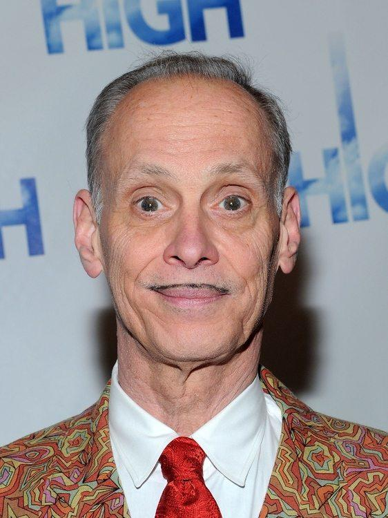 """Before """"The Wire"""" made Baltimore the cultural proxy for dysfunctional locales, <a class=""""taxInlineTagLink"""" id=""""PECLB004183"""" title=""""John Waters"""" href=""""/topic/entertainment/movies/john-waters-PECLB004183.topic"""">John Waters</a>' sense of the absurd put our often-incorrigible and provincially original burg on the map with movies such as """"Hairspray,"""" """"Polyester"""" and """"Serial Mom.""""<br> <br>  Waters' ability to capture what's unique about Baltimore is likely the reason he got the nod from b readers as the Ultimate Baltimore celebrity. After all, Waters' quick-witted persona and equal-opportunity satire have provided just what this dystopian paradise needs on occasion -- a good, self-effacing laugh.<br> <br>  This is not to say that Waters isn't a fan of """"The Wire."""" Truth is, he loves it.<br> <br>  """"The fact 'The Wire' is an image that is celebrated all over the world -- isn't that great in a way?"""" says Waters, noting that his films, along with the work of """"Wire"""" creator <a class=""""taxInlineTagLink"""" id=""""PECLB004158"""" title=""""David Simon"""" href=""""/topic/arts-culture/mass-media/david-simon-PECLB004158.topic"""">David Simon</a> and """"Diner"""" director <a class=""""taxInlineTagLink"""" id=""""PECLB004142"""" title=""""Barry Levinson"""" href=""""/topic/entertainment/movies/barry-levinson-PECLB004142.topic"""">Barry Levinson</a>, have delivered an indelible image of the city that is authentic and absurd.<br> <br>  """"I think Baltimore has always had a sense of humor; embracing it and being proud of 'The Wire' is in a way ironic.""""<br> <br>  The funny thing is, in his own idiosyncratic way, Waters is Baltimore's biggest booster, at least as he extols the city's most alluring quality in both his movies and other ventures: a penchant for embracing eccentricity sans the pretense.<br> <br> """"Everywhere I go around the world, someone comes over to me and says, 'I'm from Baltimore,' as if it's some sort of secret society."""" That's why Waters says living in Baltimore has become hip and desirable, a place for those inspired by """