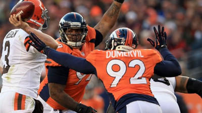 Lack of height provides leverage for Ravens' Elvis Dumervil
