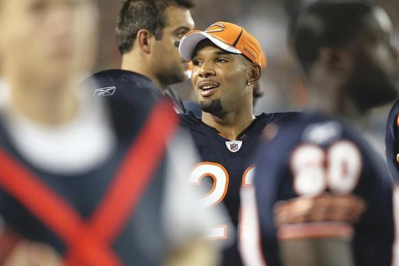 Running back Matt Forte relaxes on the bench.