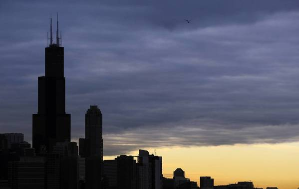 A clearing from overcast skies appears at dawn south of the Loop.