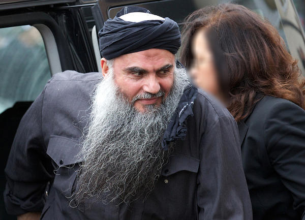 In a file picture taken Nov. 13, Jordanian terrorism suspect Abu Qatada arrives at his home in London after he was released from prison. The British government Wednesday lost an appeal against a court decision to block his deportation to Jordan.