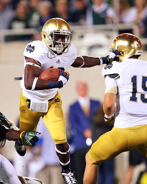 Notre Dame wide receiver Davonte Neal breaks a Michigan State tackle during their game last September.