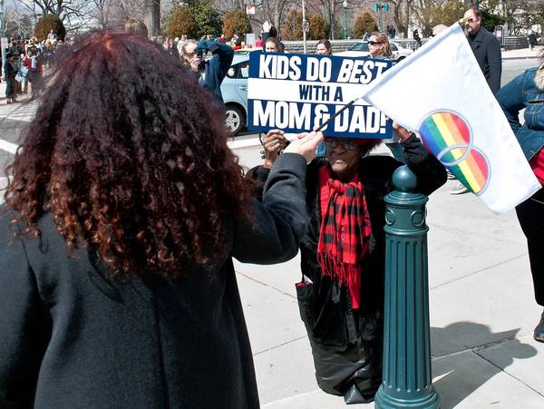 Supporters and opponents of same-sex marriage show their colors in front of the Supreme Court in Washington Tuesday.