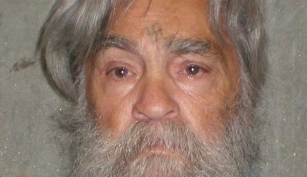 Craig Carlisle Hammond has been arrested on suspicion of trying to smuggle a cellphone to Charles Manson, pictured, at Corcoran State Prison in Central California.