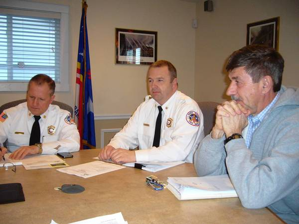 Park Ridge officials (left to right) Fire Chief Mike Zywanski, Deputy Fire Chief Jeff Sorensen and Police Chief Frank Kaminski discuss potential hiring problems at the Park Ridge Fire and Police Board meeting on March 21.