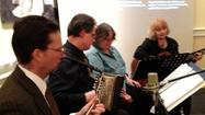 A group of Richmond musicians sang and played their way through 400 years of American history in downtown Hampton last week.