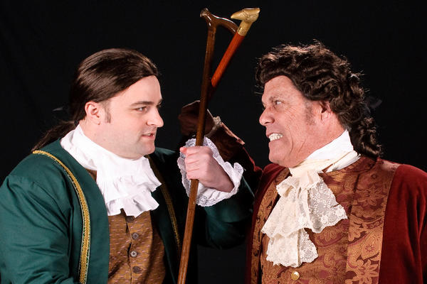 Jeff Sprague, as John Adams, left, has a heated exchange with John Dickinson, portrayed by Tim Sayles, in the Colonial Players production of the music, 1776, continuing through April 20.