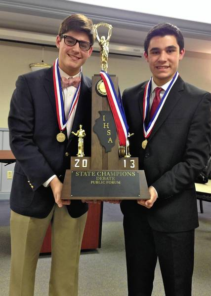 New Trier High School juniors Noah Quinn,left, and Zach Peltz recently won the IHSA state public forum debate championship in Bloomington and will go to Kentucky late next month for the national Tournament of Champions.