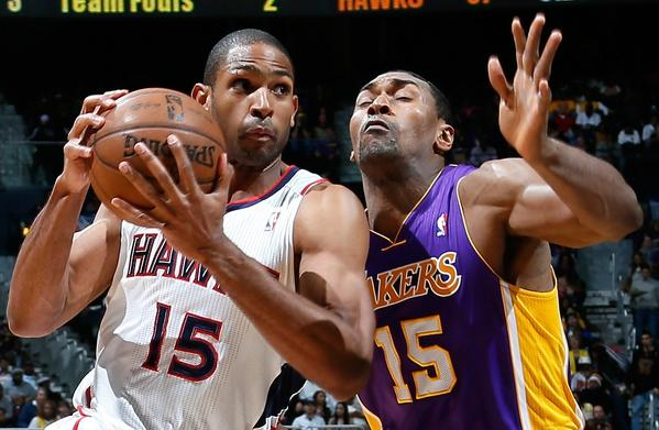 Metta World Peace, shown defending Atlanta's Al Horford, has kept his Twitter followers entertained, if not informed on his status with the Lakers.