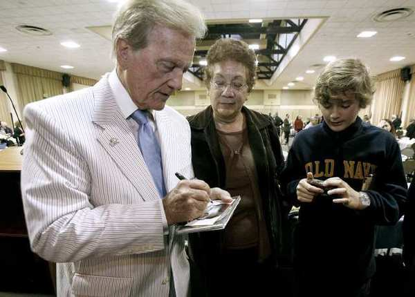 Singer, actor, writer Pat Boone signed autographs after giving the keynote address at the 50th Annual Glendale Mayor's Prayer Breakfast at the Glendale Civic Auditorium in Glendale on Thursday, March 21, 2013.