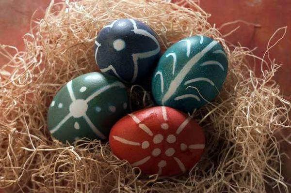 An un-dyeing process is used to create patterns on these Easter eggs.