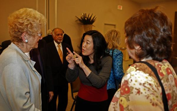 Michelle Rhee, center, answers questions after delivering a speech to the World Affairs Council in Los Angeles.