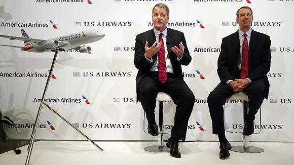 US Airways CEO Doug Parker, left, and American CEO Tom Horton answer questions during a press conference announcing the airlines' merger Feb. 14.