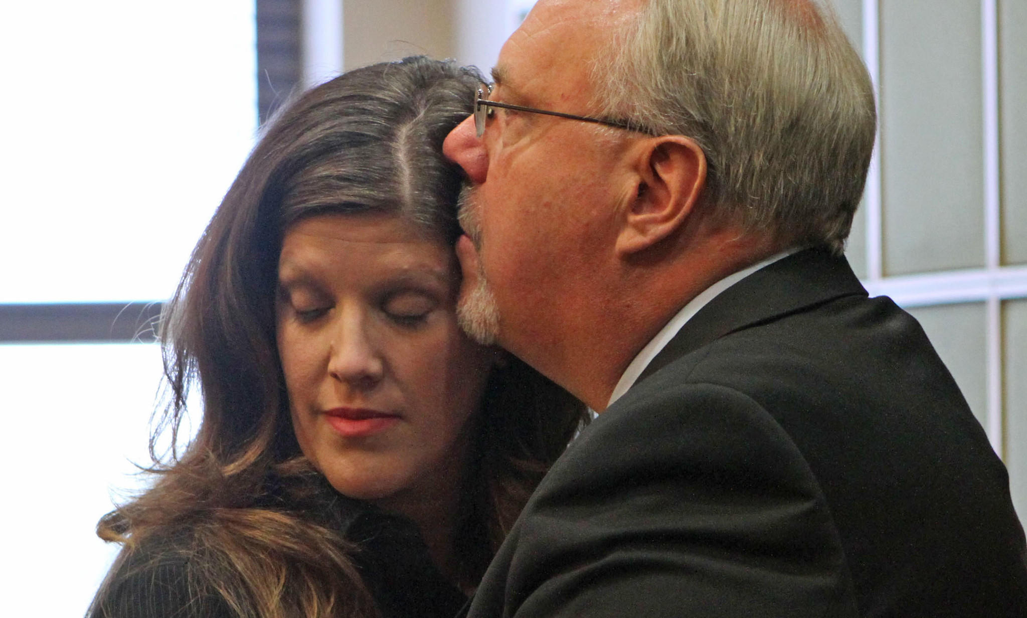 Jim Greer, right,ousted former Florida GOP chairman has an emotional moment with his wife wife Lisa before Greer was sentenced today in an Orlando court.