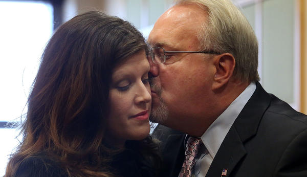 Jim Greer,right,ousted former Florida GOP chairman has an emotional moment with his wife wife Lisa before Greer was sentenced to 18 months in prison.