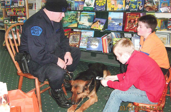 Michigan State Police Officer Jason Nemecek joined the Radcliffe Reading Society at McLean & Eakin Booksellers in Petoskey to explain the training and duties of Mako, his German shepherd. Pictured are (from left) Nemecek, Gino Oprisiu and Jason Helmer.