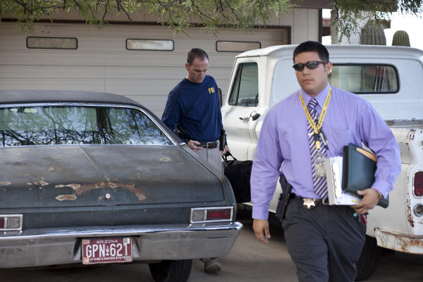 Officials from the Pima County Sheriff's Department and the FBI investigate in 2011 at the Tucson home of Jared Lee Loughner. A high school friend of his said he was never comfortable around Loughner's parents.