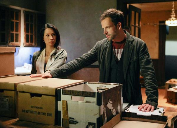 "Jonny Lee Miller and Lucy Liu in a scene from CBS' ""Elementary,"" one of at least 18 series being renewed by CBS."