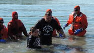 "West Chicago, Illinois: March 27, 2013 – Earlier this month, West Chicago Police Detective Robbi Peterson and his 9-year old daughter Taylor took the Polar Plunge, jumping into the icy cold water of Loon Lake in Silver Springs State Park outside of Yorkville, to kick start the West Chicago Police Department's efforts in the annual Torch Run that benefits Special Olympics. They raised $600 alone in what is being called the ""winter's coolest event""."