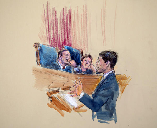 This artist rendering shows Deputy Solicitor Gen. Sri Srinivasan addressing the Supreme Court, including Justices Samuel Alito, left, and Elena Kagan, right, on Wednesday as the court heard arguments on the Defense of Marriage Act.