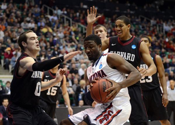Arizona's Solomon Hill drives against Harvard's Laurent Rivard (0) and Kenyatta Smith (25) on Saturday in Salt Lake City.