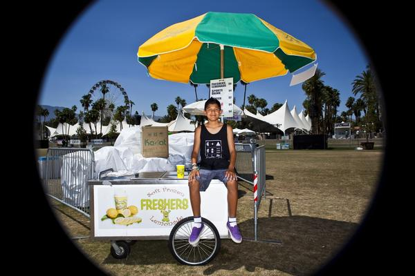Adrian Lopez, 12, from Palm Springs helped his dad, Steve, out with frozen lemonade and water last year during his first Coachella festival.