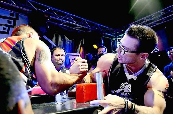 Geoff Hale, right, winner of the Middle Weight Class, prepares to pin competitor Jake Smith at the Ultimate Armwrestling League's event at the Tap House in Huntington Beach on Saturday.