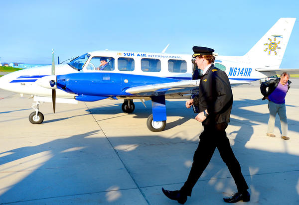 In this Herald-Mail file photo, Sun Air Chief Pilot Mark Reichard performs a post-flight inspection of the company's Piper Chieftain at Hagerstown Regional Airport. An economic impact study released Monday by the Maryland Aviation Administration ranked Hagerstown Regional Airport third out of 35 public-use airports in the state for 2012.