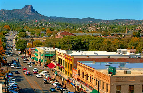 A view of Gurley Street in Prescott, Ariz., with Thumb Butte in the distance. Prescott, about 90 miles northwest of Phoenix, is becoming a desirable retirement haven, although it's more notable for its long-running rodeo, historic downtown and saloons that are the next-best thing to time travel.