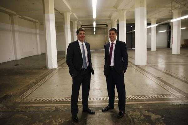 Rob Kane, left, and David Binswanger of Lincoln Property Co. on the former showroom floor of the Willys-Knight car dealership built in 1916 in downtown Los Angeles.