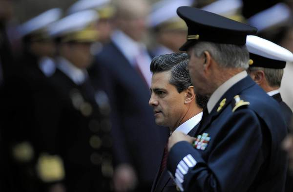 Mexican President Enrique Peña Nieto, with Defense Secretary Gen. Salvador Cienfuegos in Mexico City, plans to create a national gendarmerie as part of his security strategy.