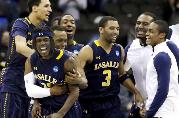 Tyrone Garland, second from left, celebrates with Tyreek Duren (3) and other teammates after hitting a layup with two seconds left to help La Salle defeat Mississippi, 76-74, in the third round of the NCAA tournament on Sunday.