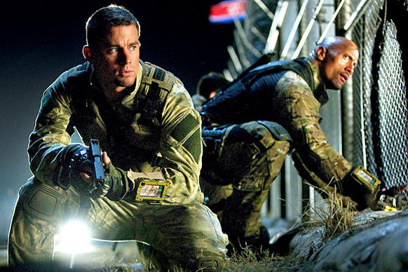 "Channing Tatum, left, is Duke and Dwayne Johnson is Roadblock in a scene from ""G.I. Joe: Retaliation."""