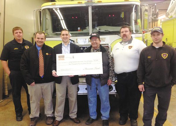 Longmeadow Fire Department received $2,500 from the Monsanto Fund. From left, firefighter Jeremy Smiley; Monsanto representative Brian Cox; Longmeadow Volunteer Fire Department President Kiel Lyons; Ben Flaherty; Fire Chief Jason Eckstine; and firefighter Bryan Evans.
