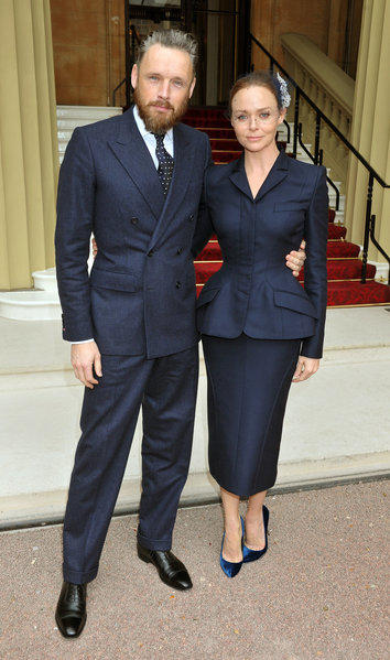 Stella McCartney arrives with husband Alasdhair Willis for a ceremony at Buckingham Palace, where she was made an officer of the Order of the British Empire.