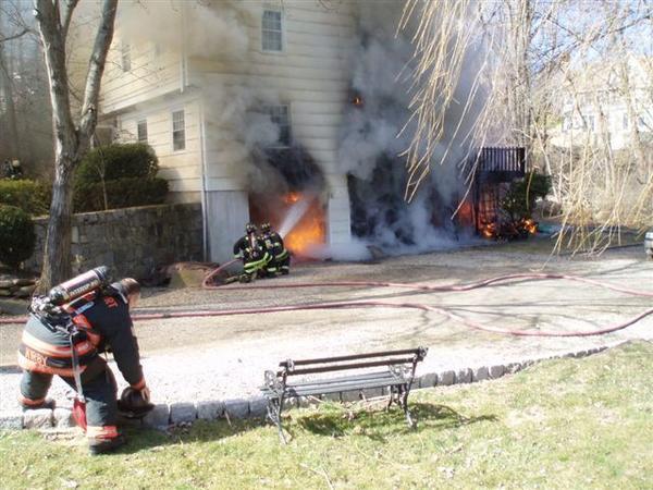Firefighters battle a garage fire on Pond Edge Road in Westport on March 27, 2013.