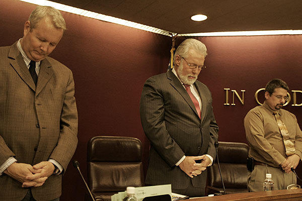 Lancaster Mayor R. Rex Parris, center, leads the opening prayer at a City Council meeting in 2011.